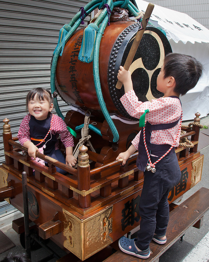 Cute Japanese children playing drum at Sanja festival in Asakusa district of Tokyo.