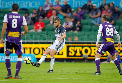 25th March 2018, nib Stadium, Perth, Australia; A League football, Perth Glory versus Melbourne Victory; Terry Antonis from Melbourne Victory passes the ball in front of Xavi Torres and Neil Kilkenny of Perth Glory