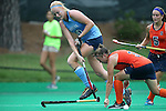 12 September 2014: North Carolina's Nina Notman (GER) (10) knocks the stick away from Syracuse's Jordan Page (3) as Alyssa Manley (5) trails the play. The University of North Carolina Tar Heels hosted the Syracuse University Orange at Francis E. Henry Stadium in Chapel Hill, North Carolina in a 2014 NCAA Division I Field Hockey match. UNC won the game 3-0.