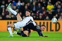Cauley Woodrow of Barnsley is fouled by Matt Grimes of Swansea City during the Sky Bet Championship match between Swansea City and Barnsley at the Liberty Stadium in Swansea, Wales, UK. Sunday 29 December 2019