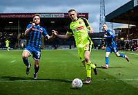 Bolton Wanderers' Ethan Hamilton (centre) breaks under pressure from  Rochdale's Callum Camps (left) <br /> <br /> Photographer Andrew Kearns/CameraSport<br /> <br /> The EFL Sky Bet League One - Rochdale v Bolton Wanderers - Saturday 11th January 2020 - Spotland Stadium - Rochdale<br /> <br /> World Copyright © 2020 CameraSport. All rights reserved. 43 Linden Ave. Countesthorpe. Leicester. England. LE8 5PG - Tel: +44 (0) 116 277 4147 - admin@camerasport.com - www.camerasport.com