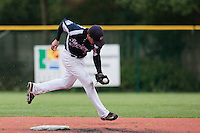 23 October 2010: Romain Scott-Martinez of Savigny grabs the ball during Savigny 8-7 win (in 12 innings) over Rouen, during game 3 of the French championship finals, in Rouen, France.