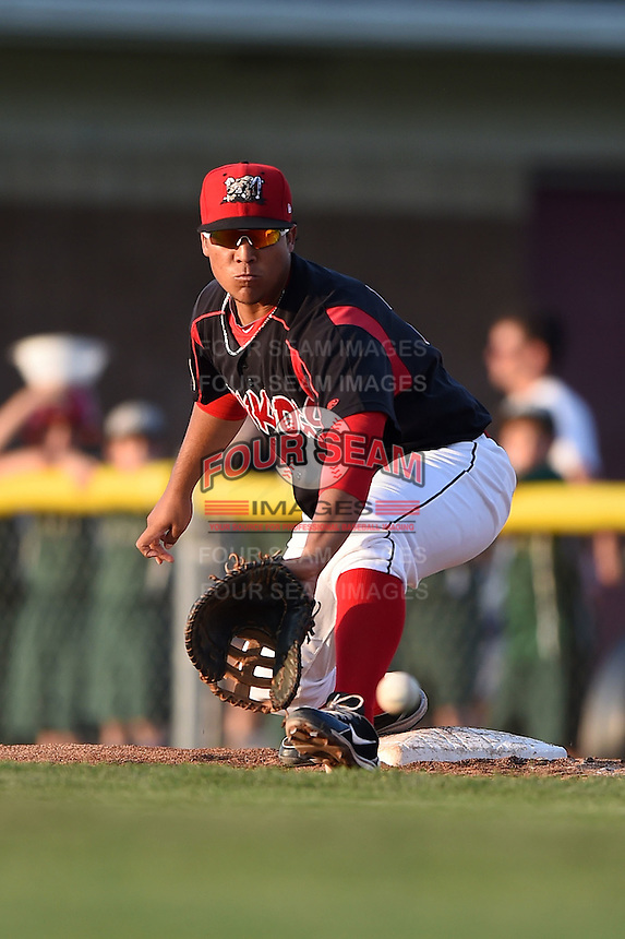 Batavia Muckdogs first baseman Carlos Duran (30) picks a low throw during a game against the Connecticut Tigers on July 21, 2014 at Dwyer Stadium in Batavia, New York.  Connecticut defeated Batavia 12-3.  (Mike Janes/Four Seam Images)