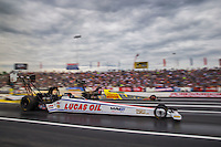 Jun 6, 2015; Englishtown, NJ, USA; NHRA top fuel driver Richie Crampton (near) races alongside Spencer Massey during qualifying for the Summernationals at Old Bridge Township Raceway Park. Mandatory Credit: Mark J. Rebilas-