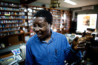 The owner of the Jazz hole, a prominent record store, feels the grove of one of his favourites nigerian performers in Nigeria's capital Lagos on Saturday March 28 2009..