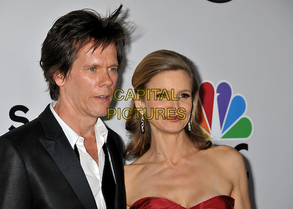 KEVIN BACON & KYRA SEDGWICK.NBC Universal 66th Annual Golden Globes Post Party at the Beverly Hilton Hotel, Beverly Hills, California, USA..January 11th, 2009.headshot portrait black jacket red strapless married husband wife .CAP/ADM/BP.©Byron Purvis/AdMedia/Capital Pictures.