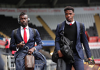 (L-R) Pape Souare and Wilfried Zaha of Crystal Palace arrive before the Barclays Premier League match between Swansea City and Crystal Palace at the Liberty Stadium, Swansea on February 06 2016