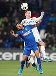 Getafe CF's Angel Rodriguez (l) and FC Krasnodar's Sergei Petrov during UEFA Europa League match. December 12,2019. (ALTERPHOTOS/Acero)