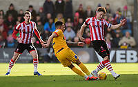 Lincoln City's Lee Frecklington vies for possession with Northampton Town's Shay Facey<br /> <br /> Photographer Chris Vaughan/CameraSport<br /> <br /> The EFL Sky Bet League Two - Lincoln City v Northampton Town - Saturday 9th February 2019 - Sincil Bank - Lincoln<br /> <br /> World Copyright &copy; 2019 CameraSport. All rights reserved. 43 Linden Ave. Countesthorpe. Leicester. England. LE8 5PG - Tel: +44 (0) 116 277 4147 - admin@camerasport.com - www.camerasport.com