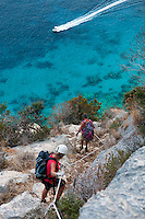 Cala Gonone, Gulf of Orosei, Sardinia, Italy, September 2012. From Cala Gonone we reach the millenium cave via a Via Ferrata (klettersteig) over the blue waters. The Millenium cave is famous for it's rock climbing. Far away from the touristic Costa Esmeralde lies the wildest coastline of Sardinia. The turquoise waters of the Gulf of Orosei are lined by steep limestone cliffs. The wild rocky hinterland, that is home to shepherds who herd their sheep through the scrubby bushes, oak and juniper trees, offers some of the most spectacular hiking in Italy. Photo by Frits Meyst/Adventure4ever.com