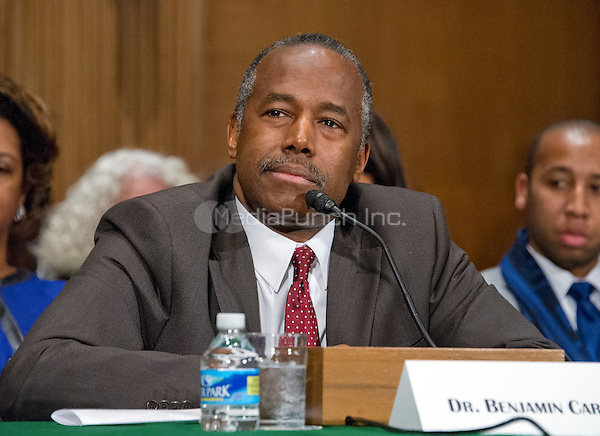 Dr. Benjamin Carson testifies before the United States Senate Committee on Banking, Housing, and Urban Affairs during a confirmation hearing on his nomination to be Secretary of Housing and Urban Development (HUD) on Capitol Hill in Washington, DC on Thursday, January 12, 2017.<br /> Credit: Ron Sachs / CNP /MediaPunch