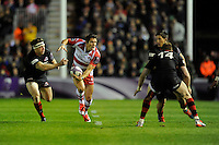 James Hook of Gloucester Rugby looks for support as he goes past Hamish Watson of Edinburgh Rugby
