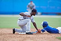GCL Tigers West second baseman Jeremiah Burks (32) tags Yhon Perez (6) sliding in during a Gulf Coast League game against the GCL Blue Jays on August 3, 2019 at the Englebert Complex in Dunedin, Florida.  GCL Blue Jays defeated the GCL Tigers West 4-3.  (Mike Janes/Four Seam Images)