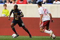 Danny Mwanga (10) of the Philadelphia Union  is marked by Mike Petke (12) of the New York Red Bulls. The New York Red Bulls defeated the Philadelphia Union 2-1 during a Major League Soccer (MLS) match at Red Bull Arena in Harrison, NJ, on April 24, 2010.