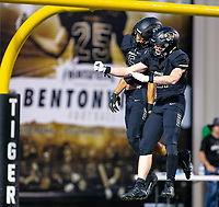 VAN BUREN VS BENTONVILLE  - Chaz Nimrod (5) and Trenton Kolb (21) of Bentonville celebrate after Chaz Nimrod scores his first touchdown of the game in the 1st quarter atTiger Stadium, Bentonville, AR, on Friday October 4 2019,   Special to NWA Democrat-Gazette/ David Beach