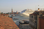 Tourists depart via cruise ship on the Grand Canal near San Marco Square, Venice, Italy. .  John offers private photo tours in Denver, Boulder and throughout Colorado, USA.  Year-round. .  John offers private photo tours in Denver, Boulder and throughout Colorado. Year-round.