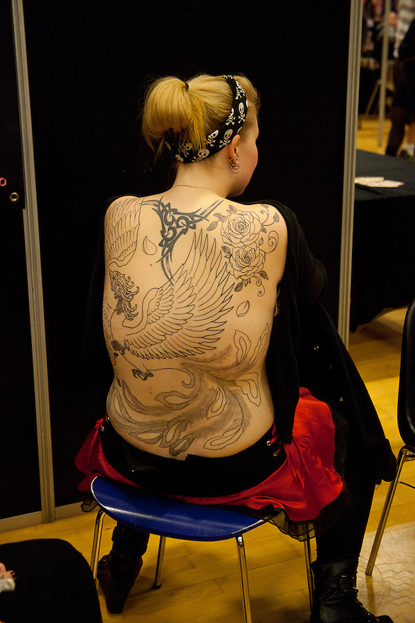 Tattoo Convention in Kolding 2011. Arranged by BodyMod.dk<br /> Backpiece on a young woman. Work in progress.