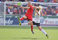 Portland, Oregon - Sunday October 2, 2016: Portland Thorns FC defender Katherine Reynolds (2) kicks the ball away from Western New York Flash midfielder McCall Zerboni (7) during a semi final match of the National Women's Soccer League (NWSL) at Providence Park.