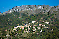 Panoramic aerial view from on high of oldest town in Corfu - ancient mountain village of Old Perithia nestled in mountains, Greece