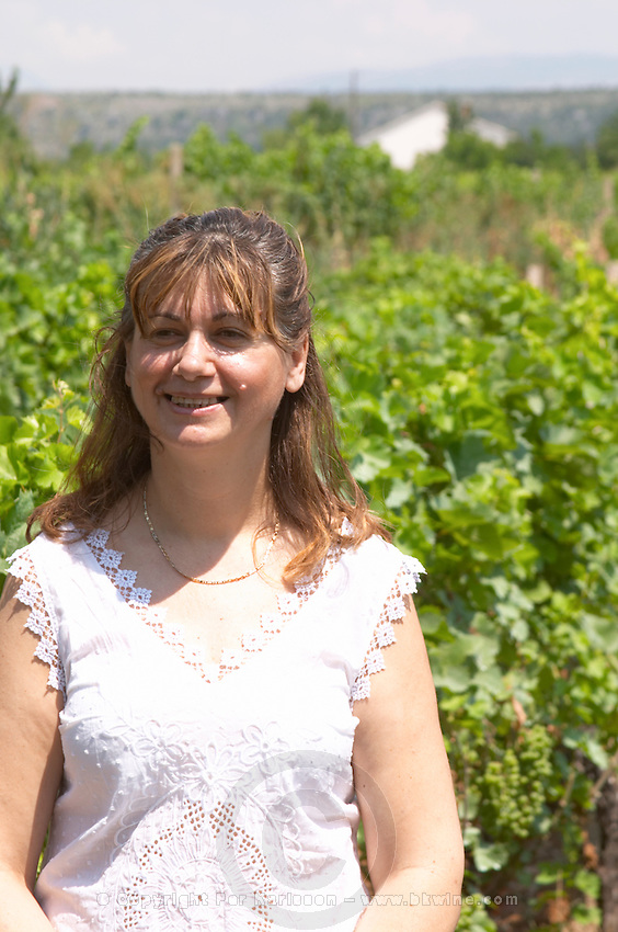 Olivera Juricic, the owner, in the vineyard. Vita@I Vitaai Vitai Gangas Winery, Citluk, near Mostar. Federation Bosne i Hercegovine. Bosnia Herzegovina, Europe.
