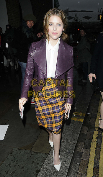 Anna Kendrick <br /> The LFW s/s 2014 Vivienne Westwood Red Label catwalk show, German Gymnasium, London, England.<br /> September 15th, 2013<br /> full length purple leather jacket white yellow yellow plaid tartan skirt<br /> CAP/CAN<br /> &copy;Can Nguyen/Capital Pictures