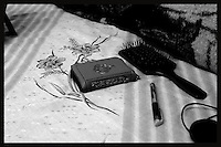A Koran, a hear brush and a pen are seen on the bed of Obeida Khalil a member of the Islamic Jihad movement in her cell at Hasharon Israeli prison. ..Khalil, 29 was arrested by Israeli soldiers when she was preparing for a suicide attack in Tel Aviv bus station. Photo by Quique Kierszenbaum..