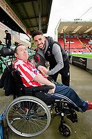 Lincoln City's Tom Pett with a fan prior to the game<br /> <br /> Photographer Chris Vaughan/CameraSport<br /> <br /> The EFL Sky Bet League One - Lincoln City v Sunderland - Saturday 5th October 2019 - Sincil Bank - Lincoln<br /> <br /> World Copyright © 2019 CameraSport. All rights reserved. 43 Linden Ave. Countesthorpe. Leicester. England. LE8 5PG - Tel: +44 (0) 116 277 4147 - admin@camerasport.com - www.camerasport.com