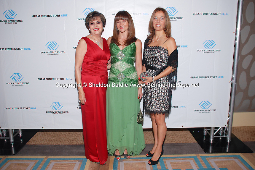 Olga Guilarte, Alba Uribe, and Claudia Rabuffo attend The Boys and Girls Club of Miami Wild About Kids 2012 Gala at The Four Seasons, Miami, FL on October 20, 2012