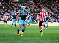 Stevenage's Luther Wildin clears under pressure from Lincoln City's Danny Rowe<br /> <br /> Photographer Andrew Vaughan/CameraSport<br /> <br /> The EFL Sky Bet League Two - Lincoln City v Stevenage - Saturday 16th February 2019 - Sincil Bank - Lincoln<br /> <br /> World Copyright © 2019 CameraSport. All rights reserved. 43 Linden Ave. Countesthorpe. Leicester. England. LE8 5PG - Tel: +44 (0) 116 277 4147 - admin@camerasport.com - www.camerasport.com