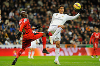 Real Madrid´s Raphael Varane and Sevilla's Stephane Mbia during 2014-15 La Liga match between Real Madrid and Sevilla at Santiago Bernabeu stadium in Alcorcon, Madrid, Spain. February 04, 2015. (ALTERPHOTOS/Luis Fernandez) /NORTEphoto.com