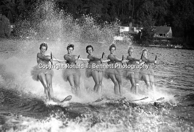 "Water skiers practice on Lake Oswego Oregon for Cypress Gardens world famous water ski show Florida,  Water skiers practice on Lake Oswego Oregon for Cypress Gardens world famous water ski show Florida, ""The Water Ski Capitol of the World,"" Cypress Gardens water ski show  with daring lifts and jumps barefoot skiing tandem jumps and world famous Cypress Gardens water ski pyramid all performed behind beautiful Nautique by Correct Craft ski boats and the graceful Delta Kite Flyer takes to the sky above the park,"