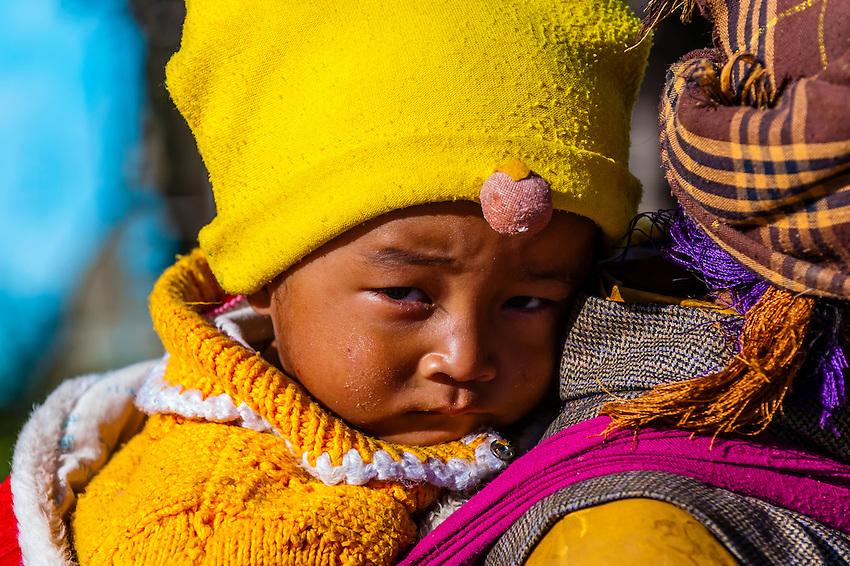 Grandmother and child, Gonggar, Shannan Prefecture, Tibet (Xizang), China.