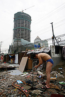 A worker cools off by washing himself from a tap at a construction site in Shanghai, China..