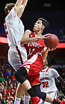 UNCASVILLE CT. 17 March 2018-031718SV07-#11 Ethan Collins of Wamogo goes up for a shot as #12 Nick Wright of Cromwell defends during the CIAC Division V Finals at Mohegan Sun Arena in Uncasville Saturday. Wamogo lost 58-40.<br /> Steven Valenti Republican-American