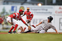 Batavia Muckdogs shortstop Javier Lopez (22) tags out Collin Slaybaugh (26) during a game against the Staten Island Yankees on August 7, 2014 at Dwyer Stadium in Batavia, New York.  Staten Island defeated Batavia 2-1.  (Mike Janes/Four Seam Images)