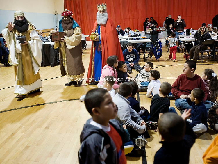 WATERBURY, CT--04 January 08--010408TJ01 - The three kings, from left, Gaspar, or Felix Rodriguez, Melchior, or Frank Batista, and Balthasar, or Remi Acosta, pay a visit to a group of children at the River-Baldwin Recreation Center during a celebration of Three Kings Day organized by the Hispanic Coalition of Greater Waterbury on Friday, January 4, 2008. T.J. Kirkpatrick/Republican-American