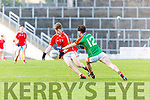 East Kerry Pa Warren sidesteps Patrick daly Mid Kerry during the County Minor Championship final in Fitzgerald Stadium on Sunday