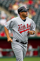 Coach Francisco Matos (32) of the Arkansas Travelers heads to the first base side during a game against the Springfield Cardinals on May 10, 2011 at Hammons Field in Springfield, Missouri.  Photo By David Welker/Four Seam Images.