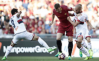 Calcio, Serie A: Roma, stadio Olimpico, 28 maggio 2017.<br /> AS Roma's Edin Dzeko (c) in action with Santiago Gentiletti (l) and Davide Biraschi (r) during the Italian Serie A football match between AS Roma and Genoa at Rome's Olympic stadium, May 28, 2017.<br /> Francesco Totti's final match with Roma after a 25-season career with his hometown club.<br /> UPDATE IMAGES PRESS/Isabella Bonotto