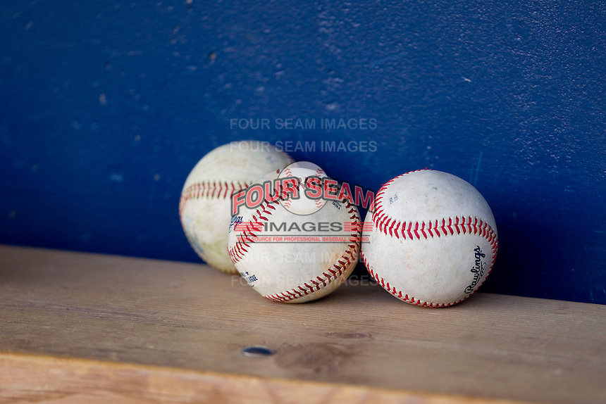International League baseballs sit on the bench in the visitor's dugout prior to the game between the Charlotte Knights and the Toledo Mudhens at 5/3 Field on May 3, 2013 in Toledo, Ohio.  The Knights defeated the Mudhens 10-2.  (Brian Westerholt/Four Seam Images)