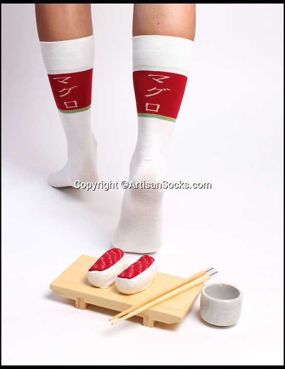 BNPS.co.uk (01202 558833)<br /> Pic: ArtisanSocks/BNPS<br /> <br /> ***Must Use Full Byline***<br /> <br /> Tuna Maguro sushi socks.<br /> <br /> Soft Sushi Shuffle...<br /> <br /> Now, should you wish to, you can make your sock draw look like a sushi bar.<br /> <br /> These morsels of mouthwatering sushi might look tantalising but you wouldn't want to eat them - because they're actually rolled up socks.<br /> <br /> The super-realistic items of clothing are the latest bizarre trend sweeping the fashion world and have been an instant hit with shoppers.<br /> <br /> Unrolled they look like any other sock but rolled up they form seven different varieties of the raw fish snack, transforming your underwear drawer into a smorgasbord of sushi.<br /> <br /> The life-like 'flavours' include egg (tamago), salmon roe (ikura), shrimp (ebi), octopus (tako), tuna (maguro ), salmon (sa-mon) and trout (masuzishi).<br /> <br /> Sushi socks cost $6 a pair - around £3.70 - and can be bought from artisansocks.com.