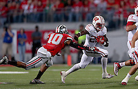 Wisconsin Badgers running back Melvin Gordon (25) gets past Ohio State Buckeyes linebacker Ryan Shazier (10) during the first half of the game between Ohio State and Wisconsin at Ohio Stadium on Saturday, September 28, 2013. (Columbus Dispatch photo by Jonathan Quilter)