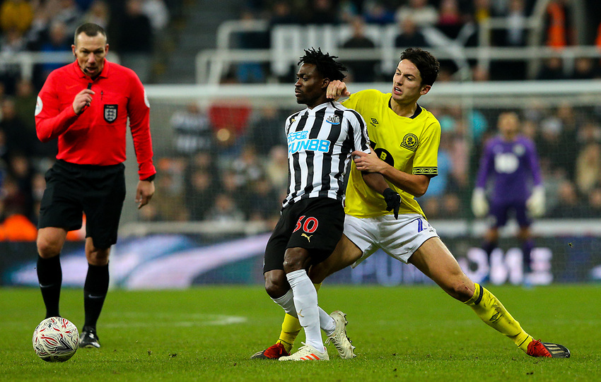 Newcastle United's Christian Atsu is fouled by Blackburn Rovers' Lewis Travis<br /> <br /> Photographer Alex Dodd/CameraSport<br /> <br /> Emirates FA Cup Third Round - Newcastle United v Blackburn Rovers - Saturday 5th January 2019 - St James' Park - Newcastle<br />  <br /> World Copyright © 2019 CameraSport. All rights reserved. 43 Linden Ave. Countesthorpe. Leicester. England. LE8 5PG - Tel: +44 (0) 116 277 4147 - admin@camerasport.com - www.camerasport.com