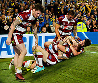 Wigan Warriors' Dominic Manfredi is mobbed after scoring a late try<br /> <br /> Photographer Alex Dodd/CameraSport<br /> <br /> Betfred Super League Grand Final - Wigan Warriors v Warrington Wolves - Saturday 13th October 2018 - Old Trafford - Manchester<br /> <br /> World Copyright © 2018 CameraSport. All rights reserved. 43 Linden Ave. Countesthorpe. Leicester. England. LE8 5PG - Tel: +44 (0) 116 277 4147 - admin@camerasport.com - www.camerasport.com