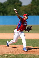 Raimar Navarro works out at the Dominican Republic air force base in front of 100+ Major League Baseball scouts prior to being declared eligible to sign since defecting from his native Cuba in Santo Domingo, Dominican Republic on February 11, 2015 (Bill Mitchell)