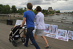 Mother and father pushing baby stroller on Pont Solferino in Paris, France. .  John offers private photo tours in Denver, Boulder and throughout Colorado, USA.  Year-round. .  John offers private photo tours in Denver, Boulder and throughout Colorado. Year-round.