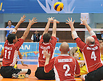 November 18 2011 - Guadalajara, Mexico:  Jose Rebelo, Douglas Learoyd and Larry Matthews of Team Canada bloack a shot while taking on Columbia in the Bronze Medal Game in the Pan American Volleyball Complex at the 2011 Parapan American Games in Guadalajara, Mexico.  Photos: Matthew Murnaghan/Canadian Paralympic Committee