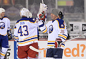 Matthew Barnaby (36) and Martin Biron (43) greet each other after The Frozen Frontier Buffalo Sabres vs. Rochester Amerks Alumni Game at Frontier Field on December 15, 2013 in Rochester, New York.  (Copyright Mike Janes Photography)