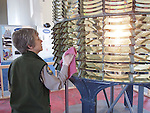 Julie Barrow cleaning the fresnel lens at Pigeon Point Light Station