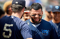Mobile BayBears Julian Leon (20) gets splashed with water after hitting a home run during a Southern League game against the Montgomery Biscuits on May 2, 2019 at Riverwalk Stadium in Montgomery, Alabama.  Mobile defeated Montgomery 3-1.  (Mike Janes/Four Seam Images)
